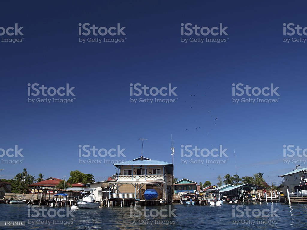 colonial house on water royalty-free stock photo