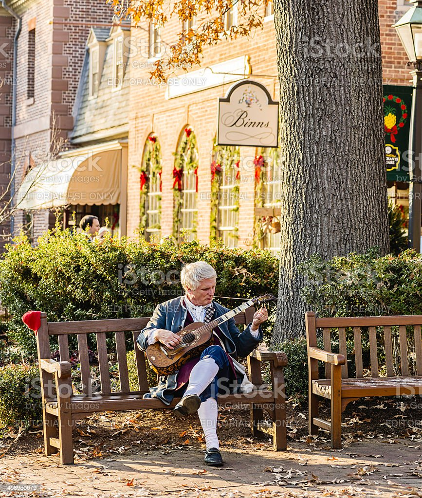 Colonial Man Playing Stringed Instrument stock photo