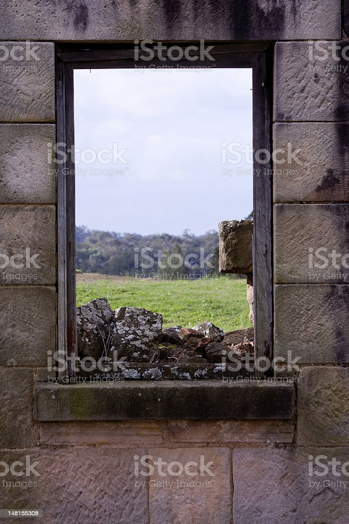 Colonial sandstone window frame overlooking field royalty-free stock photo