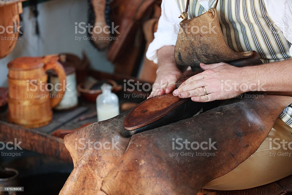 Colonial shoemaker in Williamsburg, Va stock photo