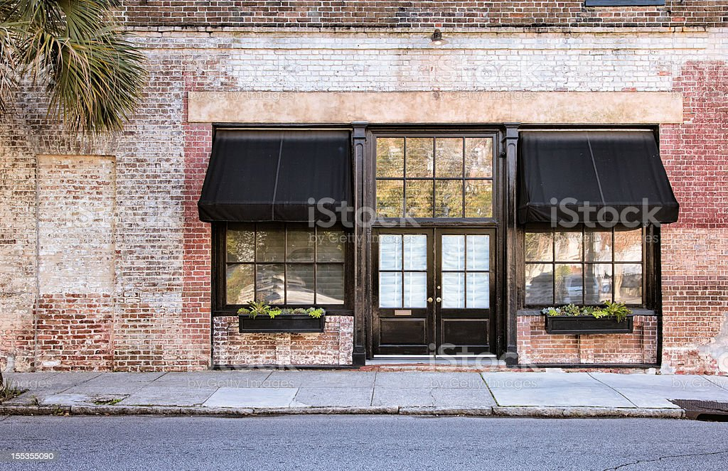 Colonial Storefront with awnings stock photo