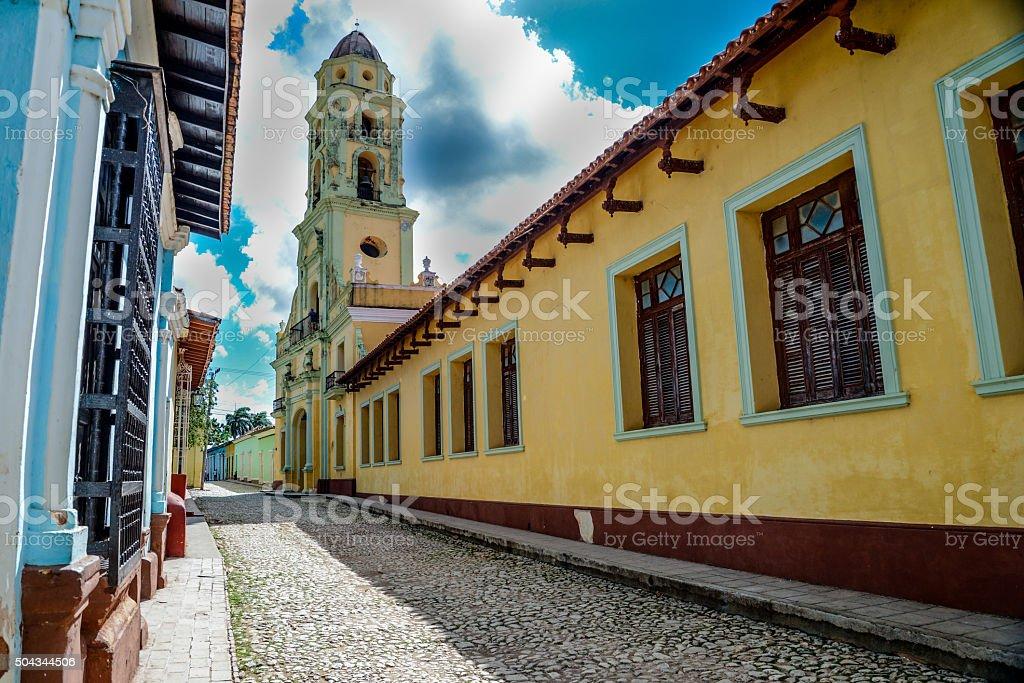Colonial street in vibrant city of Trinidad, Cuba stock photo