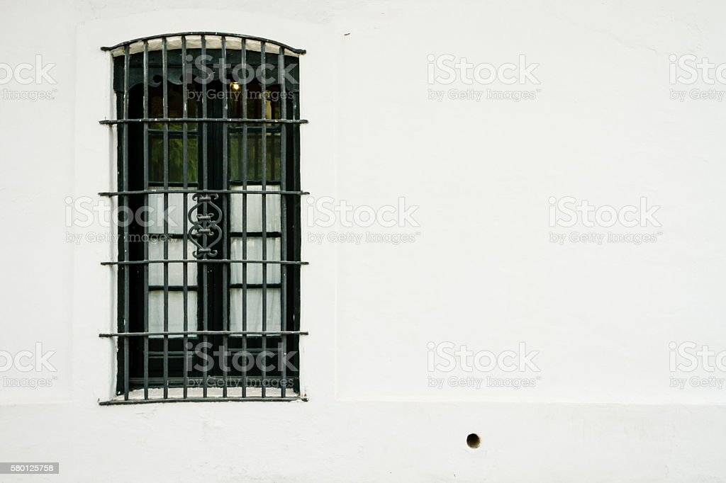 Colonial window with ironwork lattice at Argentina stock photo