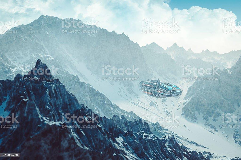 Colonization mothership flying low between alien mountain peaks stock photo