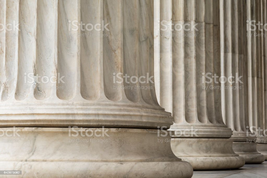 Colonnade of  Ionic order columns, close up. stock photo