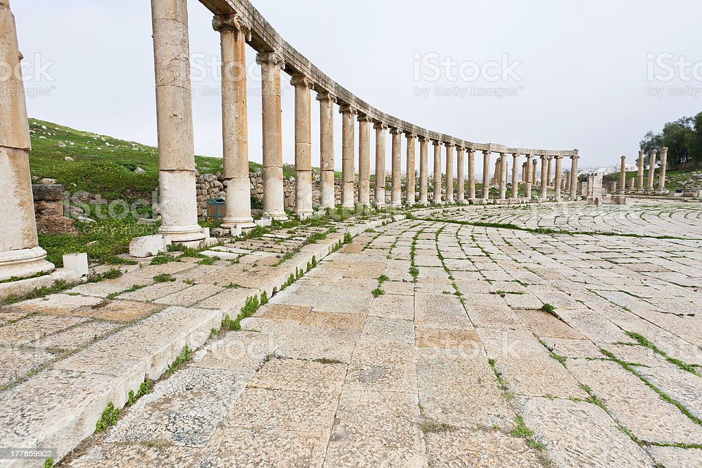 colonnade on the roman oval forum in antique town Jerash stock photo