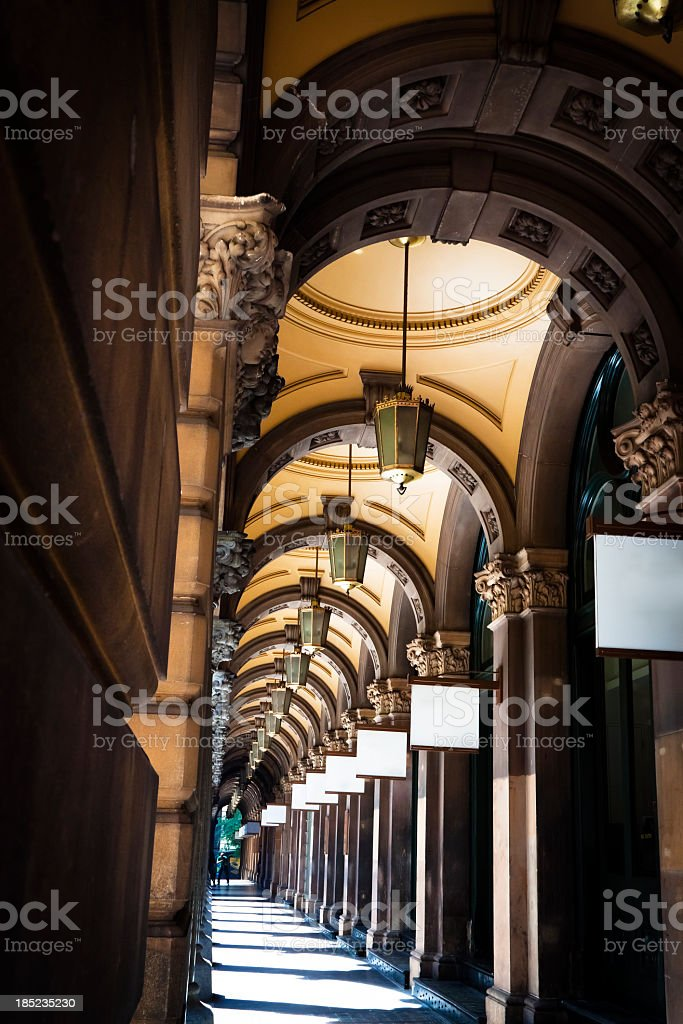 Colonnade with columns and empty white shop signs royalty-free stock photo