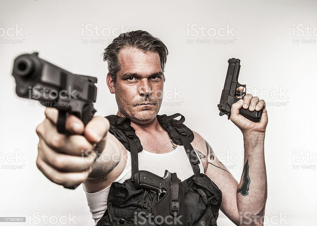 Color Action Hero Wielding Two Handguns Wearing Tactical Vest Se stock photo