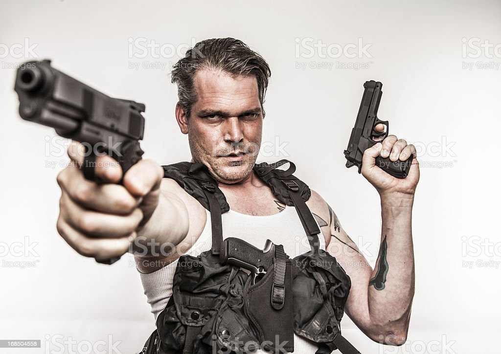 Color Action Hero Wielding Two Handguns Wearing Tactical Vest Smirk stock photo