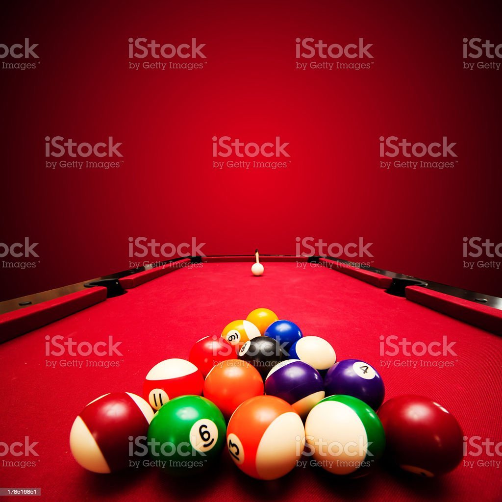Color balls in triangle, aiming at cue ball stock photo