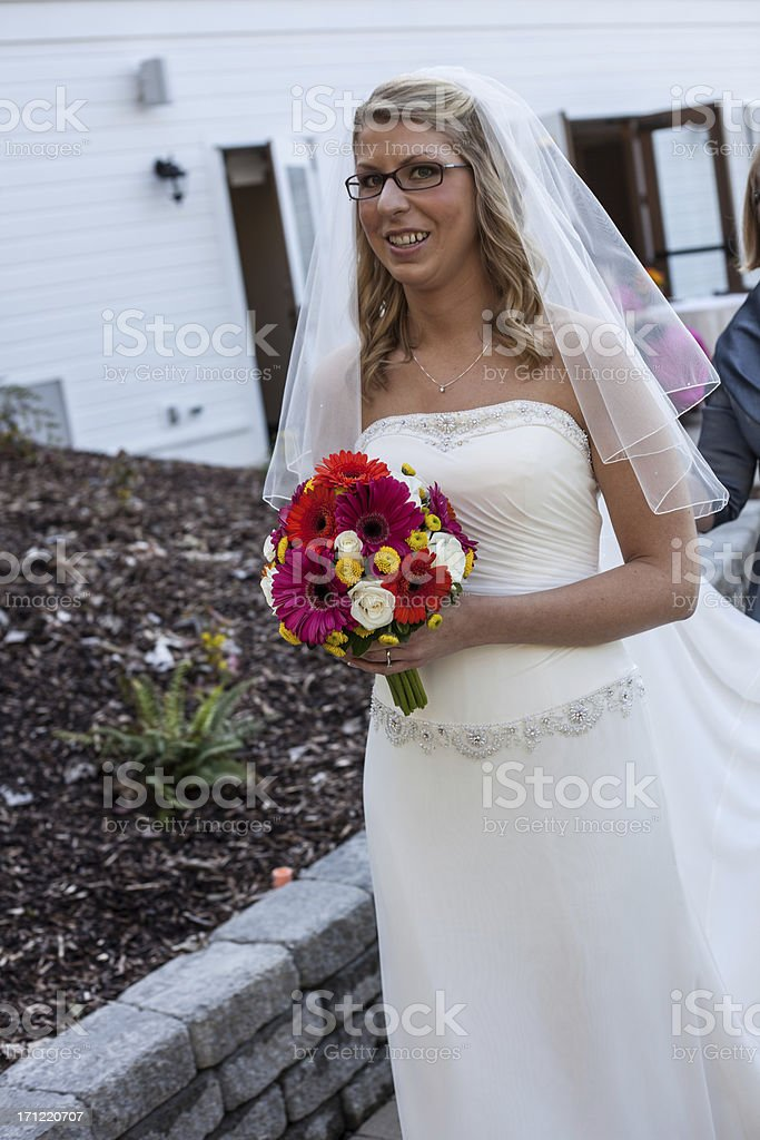 Color Blonde Veiled Bride to be with Vibrant Bouquet Walking. royalty-free stock photo