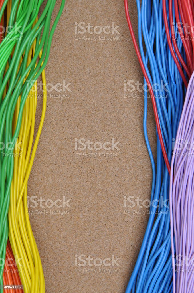 Color cables on brown felt stock photo