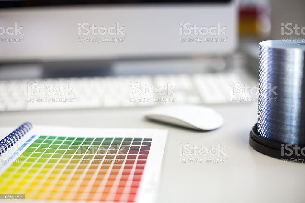 CMYK Color chart on desk stock photo