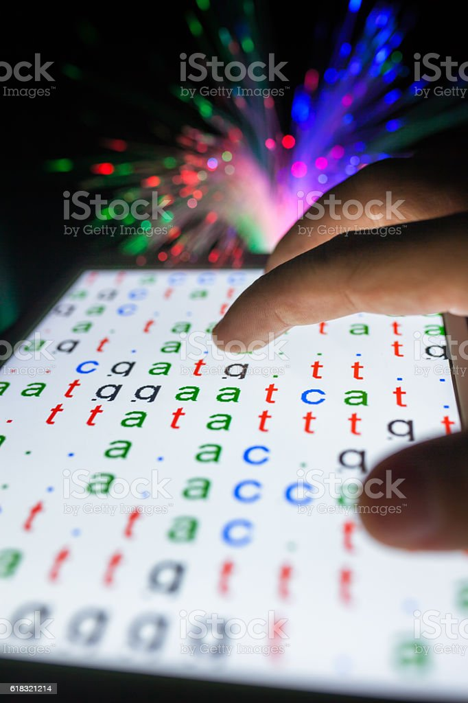 DNA color coded codes show on tablet stock photo
