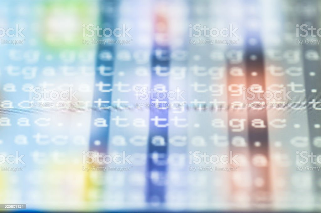 color coded DNA sequence on touch pad stock photo
