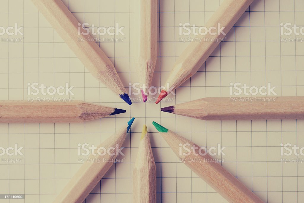 Color Crayons on graph paper from above vintage photo royalty-free stock photo