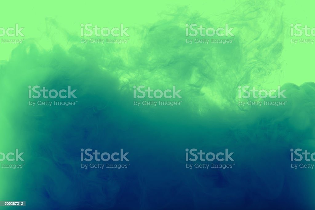 Color drop in water, photographed motion stock photo