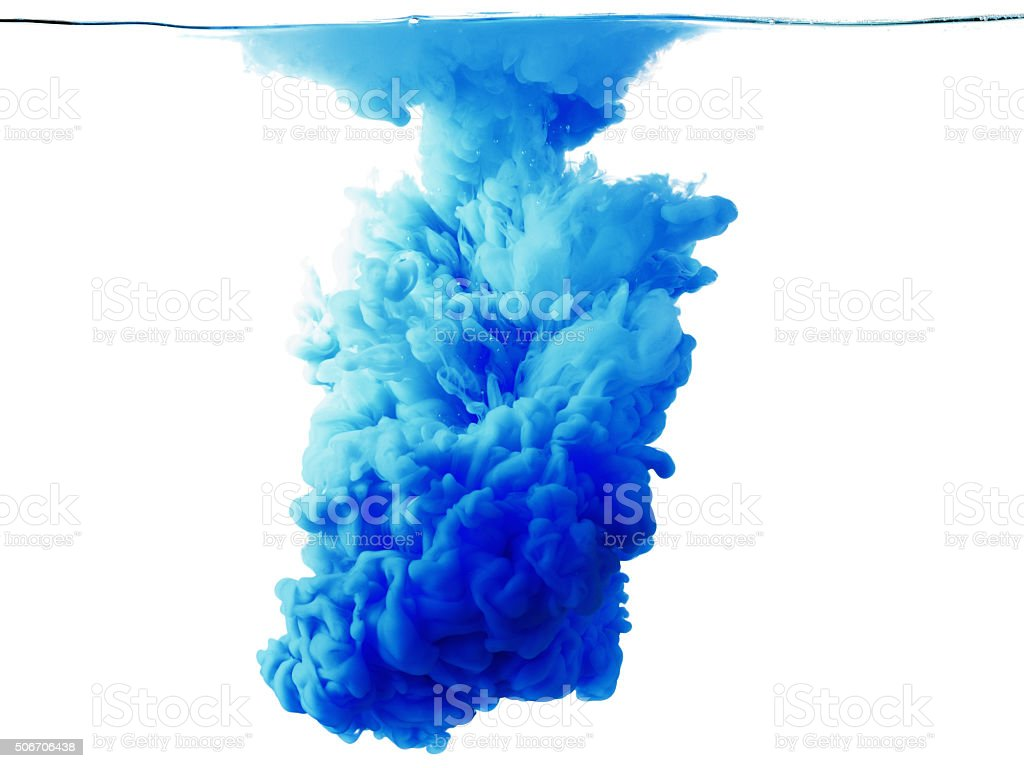 Color drop in water, photographed motion. stock photo