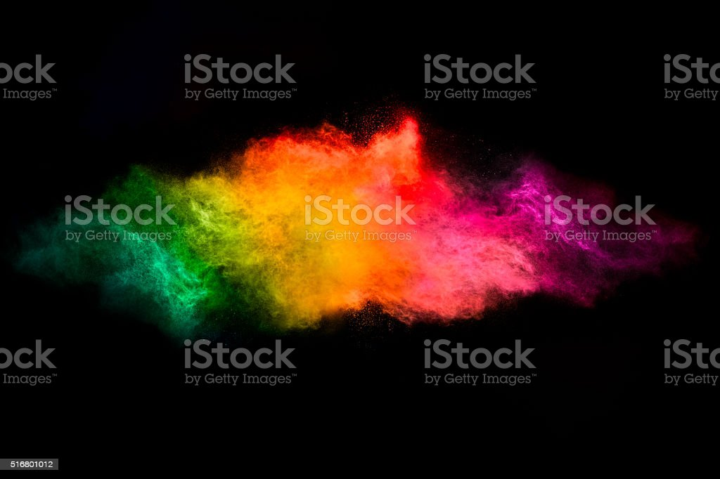 Color Explosion. Dust Particle Isolated on Black Background stock photo