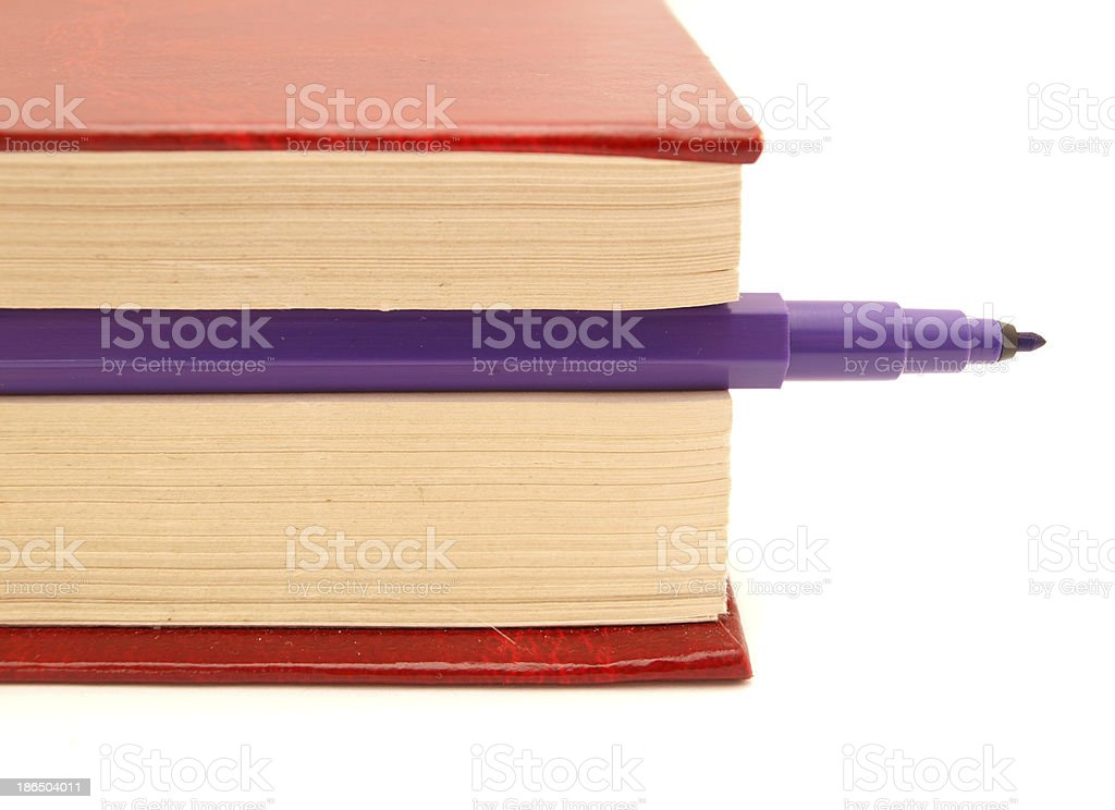 Color felt-tip pens and book royalty-free stock photo