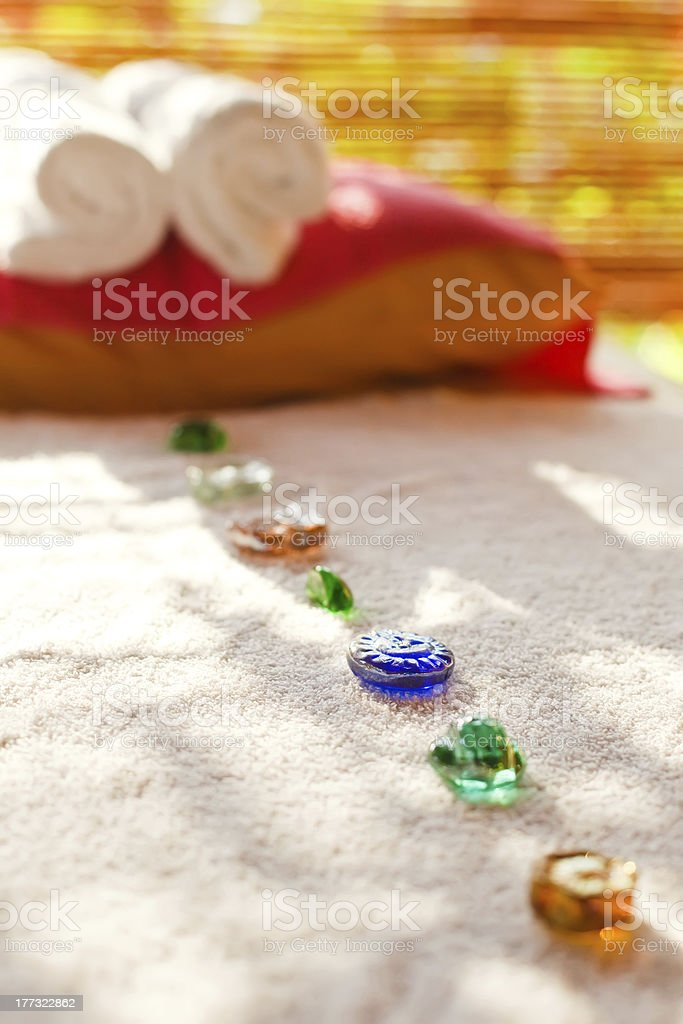 color glass stones on massage table in spa-salon royalty-free stock photo