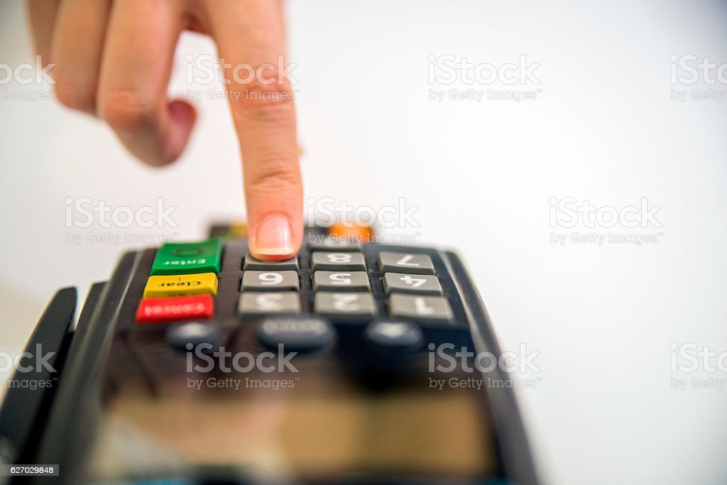 Color image of a POS and credit cards. stock photo