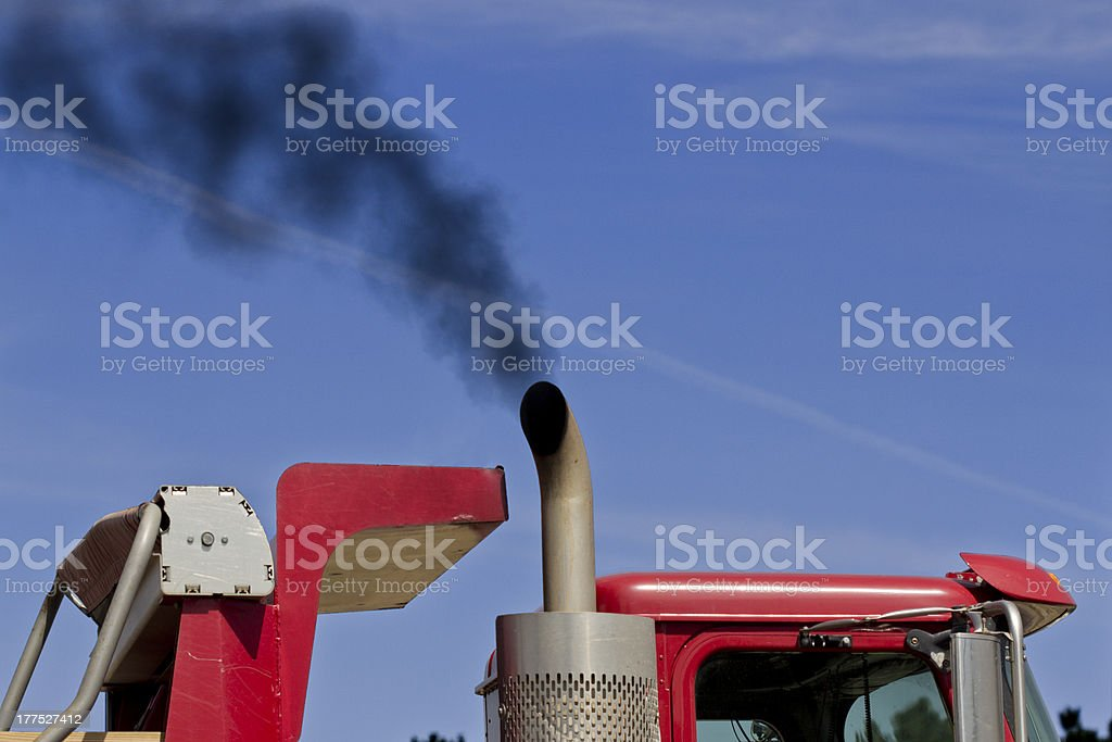 Color Image of Black Exhaust From a Red Truck stock photo