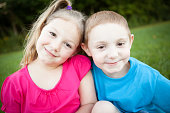 Color Image of Brother and Sister Smiling Together Outside