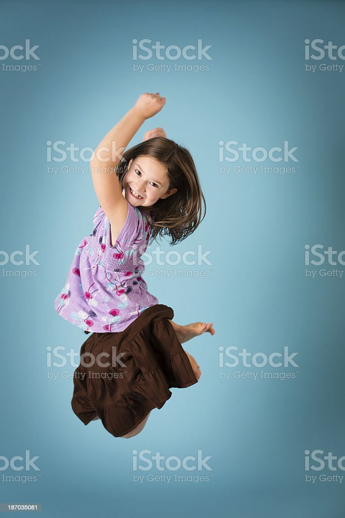Color Image of Eight Year Old Girl Jumping for Joy royalty-free stock photo