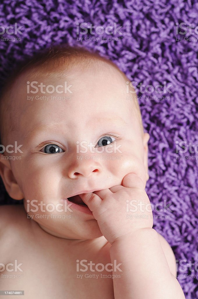 Color Image of Happy Baby Sucking on Fingers royalty-free stock photo