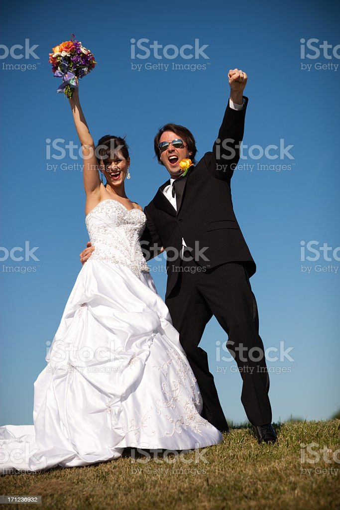 Color Image of Happy Bride and Groom Celebrating Outdoors royalty-free stock photo