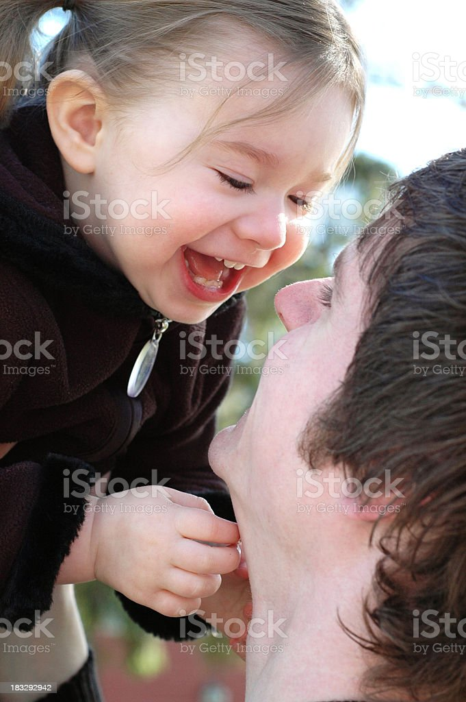 Color Image of Little Girl and Her Daddy Having Fun royalty-free stock photo