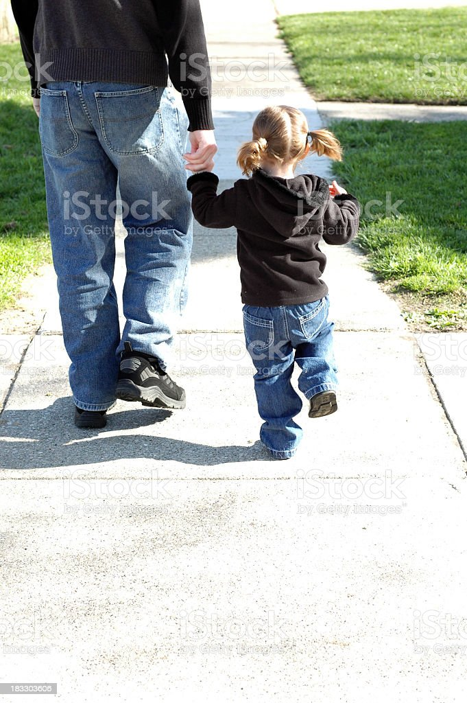 Color Image of Little Girl Walking with Her Daddy royalty-free stock photo