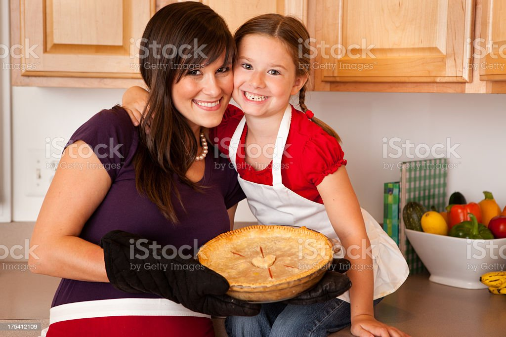 Color Image of Mother and Daughter Showing Pie They Baked royalty-free stock photo