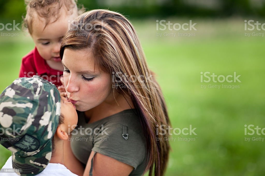 Color Image of Mother Kissing Her Son, With Copy Space royalty-free stock photo
