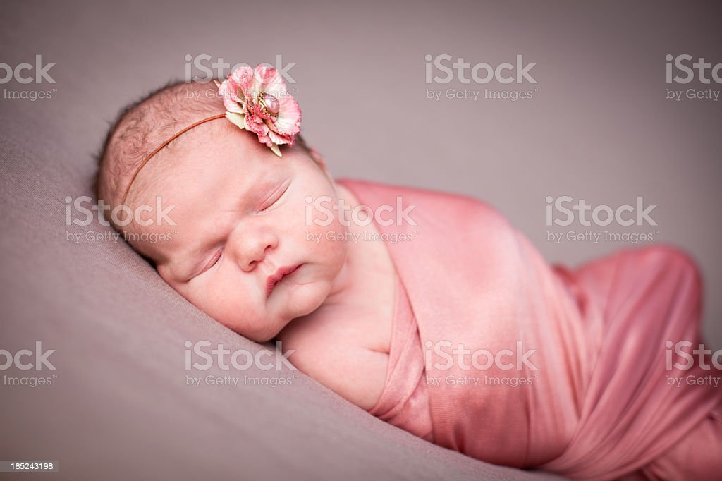 Color Image of Newborn Baby Girl Wrapped in Blanket royalty-free stock photo