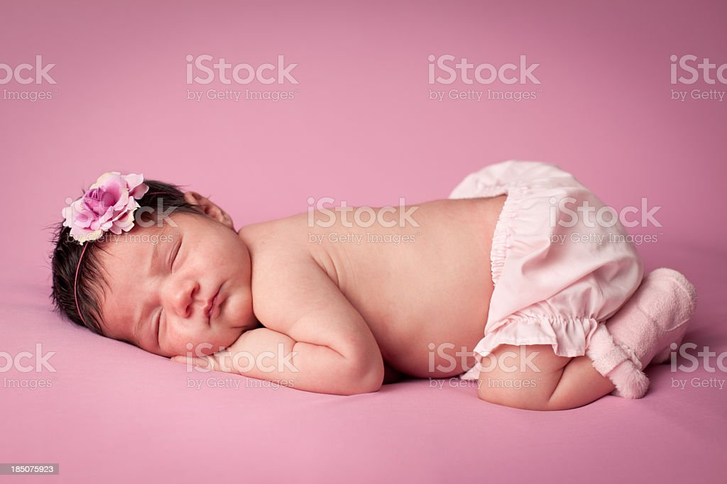 Color Image of Precious Newborn Baby Girl, on Pink Background stock photo
