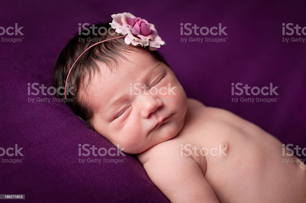 Color Image of Precious Newborn Baby Girl, With Purple Background royalty-free stock photo