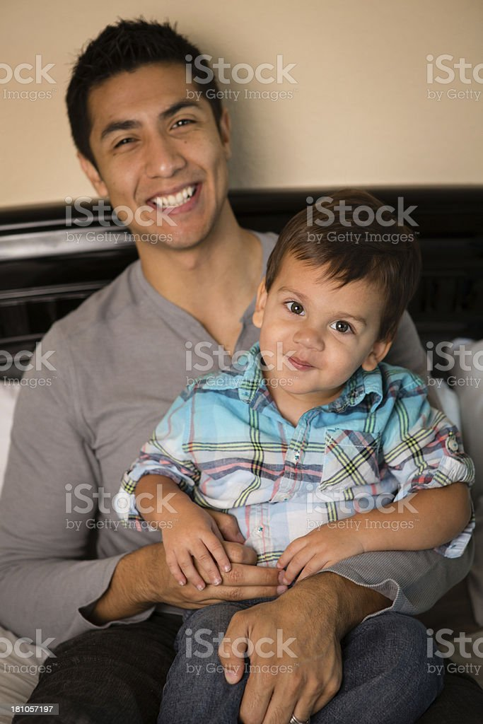 Color Image of Proud Father Holding His Toddler Son royalty-free stock photo