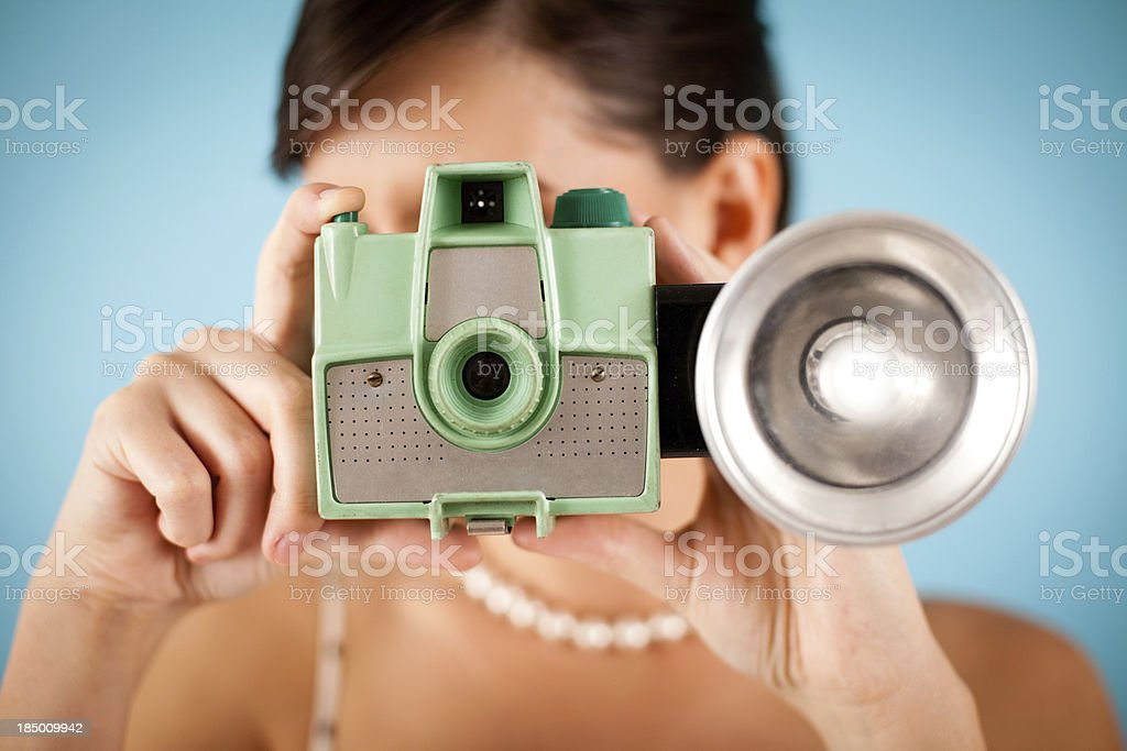 Color Image of Retro Gal Holding a Vintage Camera royalty-free stock photo