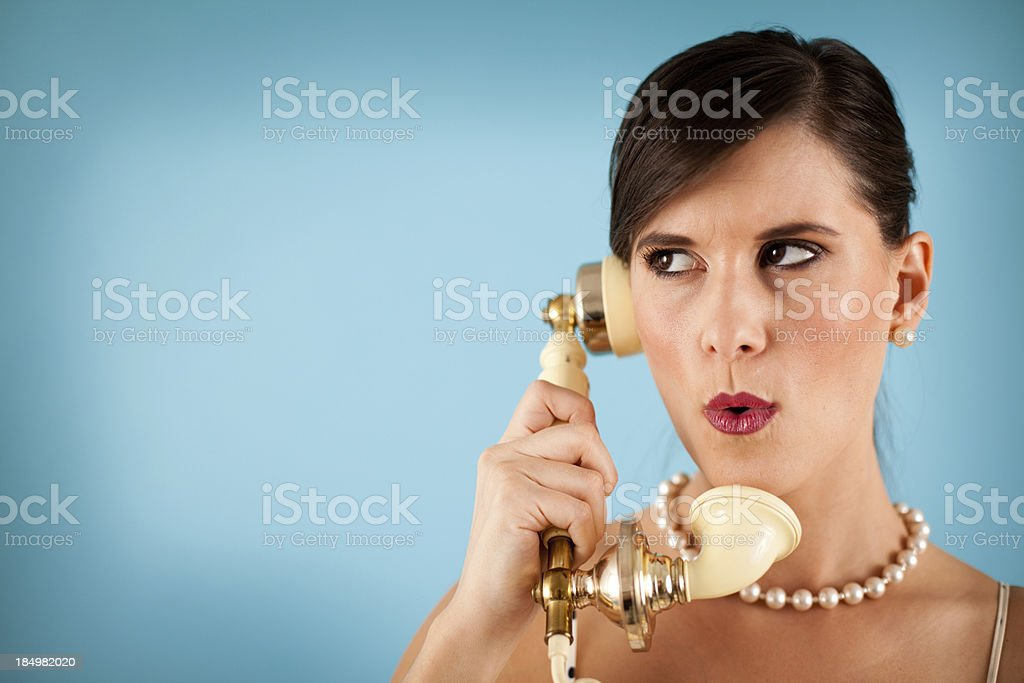 Color Image of Retro Gal Holding a Vintage Telephone royalty-free stock photo