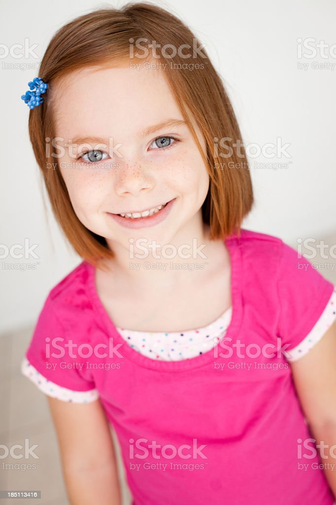 Color Image of Smiling Little Girl With Red Hair royalty-free stock photo