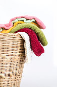 color mix  towel in wicker baskets on white background