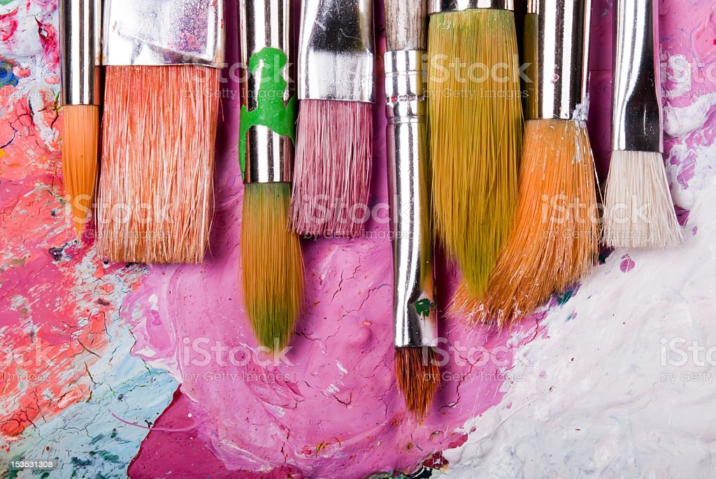 A color paint palette and paintbrushes stock photo