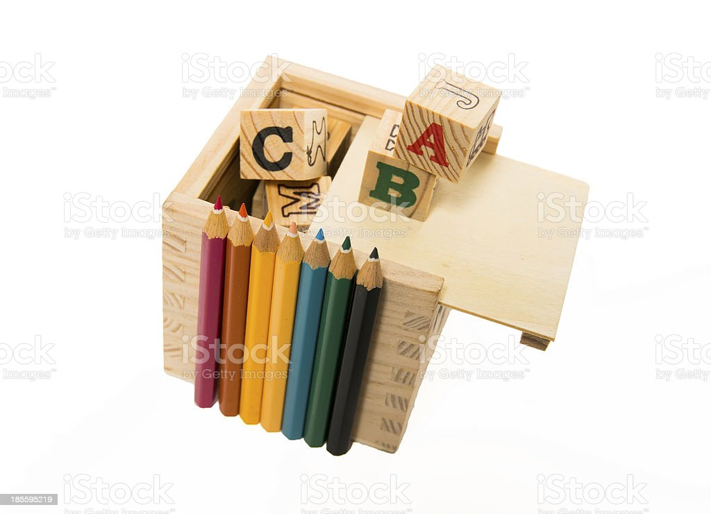 Color pencil arrange in front of wooden alphabet block box royalty-free stock photo
