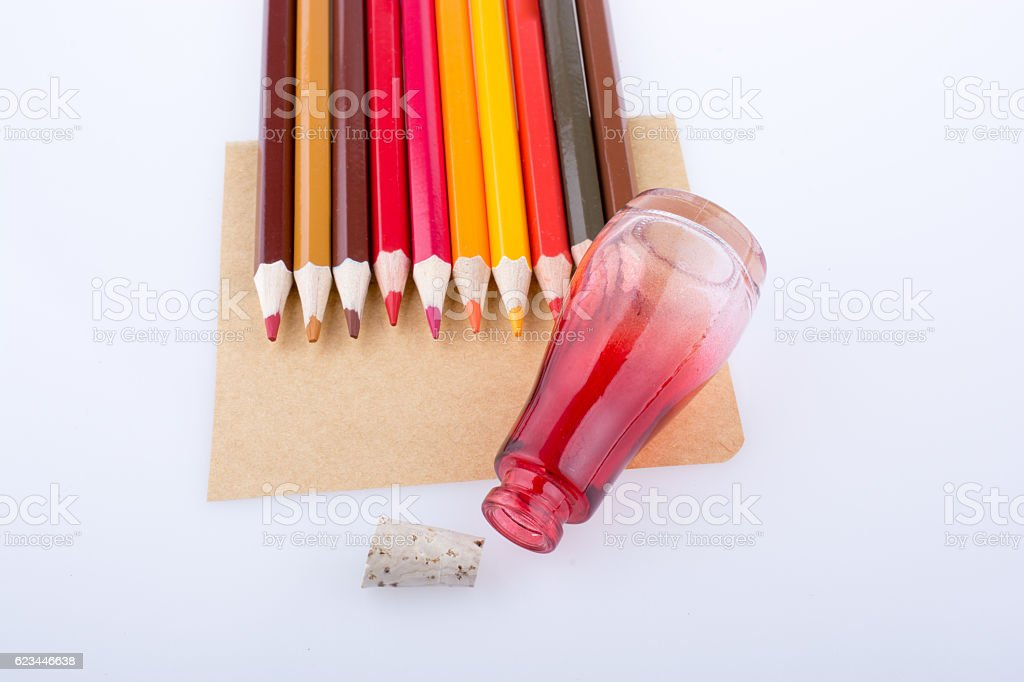 Color pencils and a bottle with cork stock photo