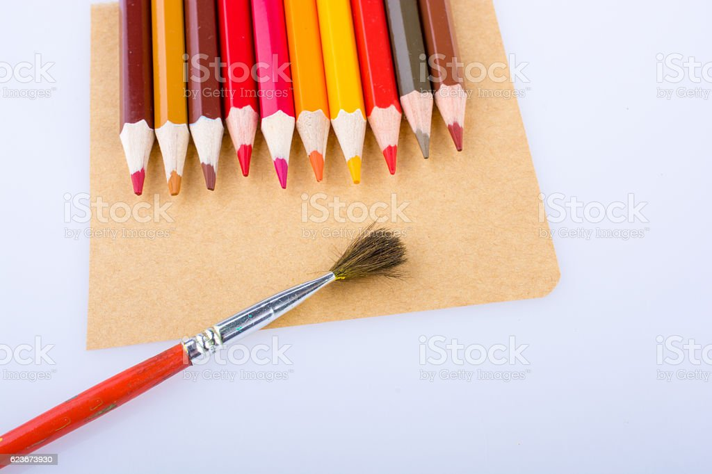 Color pencils and a brush stock photo