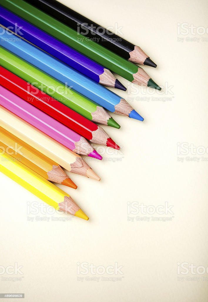 Color pencils crayons on paper background stock photo
