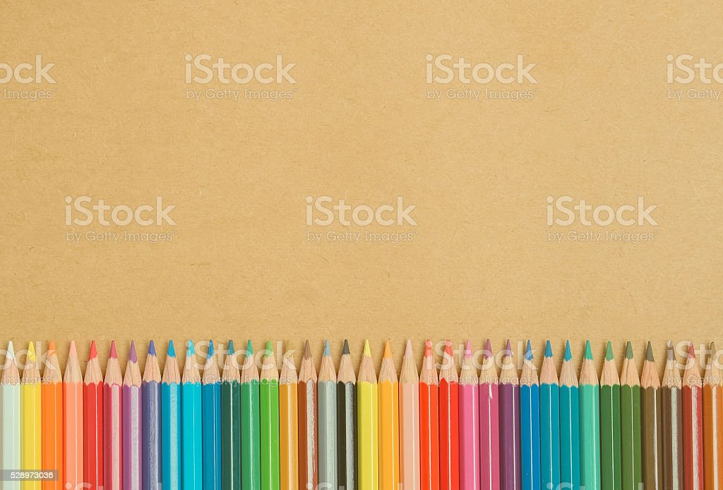 color pencils on craft paper background stock photo