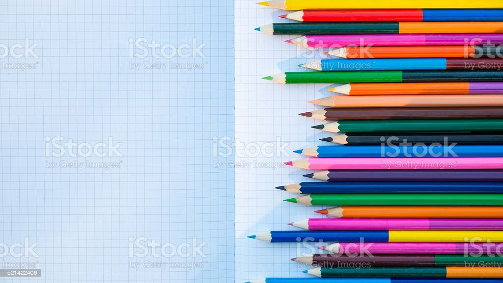color pencils on notebook stock photo